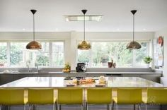 Kitchen with beautiful Tom Dixon void lights.