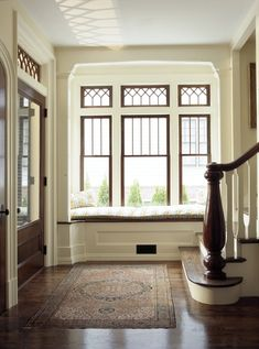 Beautiful leaded glass windows and window seat. The railing style is all wrong for a craftsman.