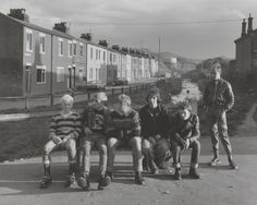 """Chris Killip  'Leso, Blackie, Bever, ?, David, on a bench, Whippet standing, Skinningrove (Leso and David were to drown of Skinningrove on July 29, 1986)', 1982, printed 2012–13"""