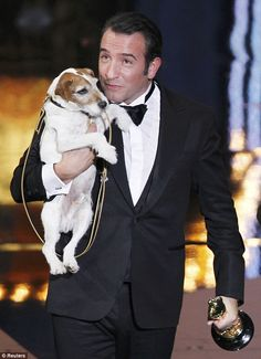 Jean Dujardin shares the spotlight with Uggie the dog.