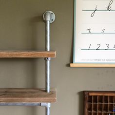 Scandinavian style children's desk with shelves. Built out of scaffolding planks, pipe and fittings.