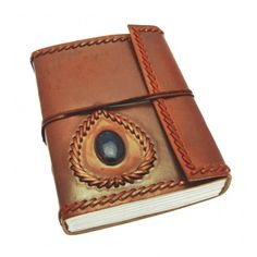 Stunning Leather journal holding semi-precious blue Lapis stone  http://www.paperhigh.com/handmade-journals-1/classic-leather/large-stitched-and-stoned-leather-journal.html