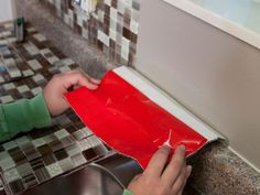 Kitchen Remodeling Project How to Install a Backsplash in a Box : How-To : DIY Network - Easy DIY steps with pro results — all from a ready-to-use kit. See how to transform your kitchen in about two hours with chic, glass peel-and-stick tiles. Self Adhesive Backsplash Tiles, Kitchen Backsplash Peel And Stick, Peel And Stick Tile, Stick On Tiles, Kitchen Countertops, Backsplash Ideas, Adhesive Tiles, Tile Ideas, Paint Countertops