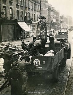 Take a look at the Removal of bomb from Brixton Hill, London. - Removal of bomb from Brixton Hill' prints from Mirror Photos Vintage London, Old London, East London, London History, British History, Brixton Hill, London Bombings, Royal Engineers, The Blitz