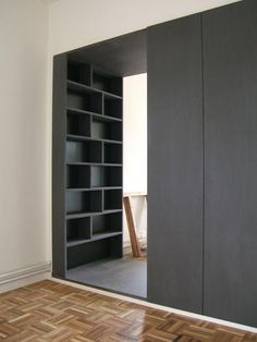 This would be a cool secret walk in closet if the shelves closed like a door.