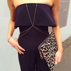 Close up detail of the Mara Strapless Jumpsuit, Chloe Body Chain, Madeleine Ring Bracelet and Jaded Clutch, available in Boutiques and Online xx