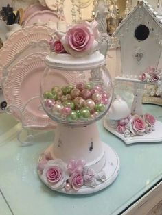 shabby chic terra cotta candy dish and in the background a bejeweled birdhouse #shabbychicbedroomsdiy