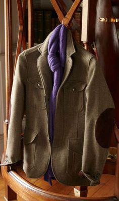 Outerwear from Ralph Lauren Purple Label: Crafted in Italy from rich wool tweed with a water-resistant finish, this sport coat features classic hunting-inspired suede elbow patches and trim. A distinctive example of functional luxury, it is filled for warmth and combines a casual zip front with a contoured silhouette.: