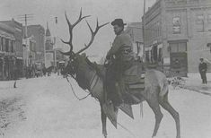 La Grande, Oregon and presumably taken in the early 1900's.... But THINK about it. This man is riding an ELK!!! hahaha that is amazing!