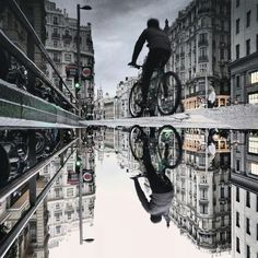 The Parallel Worlds of Puddles - Puddles of Madrid, Spain.