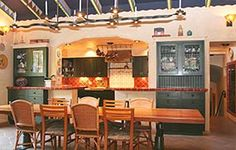 Red and green Spanish Revival kitchen