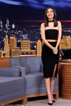 Double trouble:For her appearance, Victoria stepped out in a high wasted black skirt with...