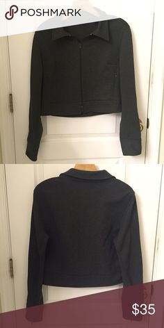 Express Dark Gray Jacket A basic dark gray jacket by Express, perfect for a dressier outfit. The jacket has some spandex in it so it is stretchy. There are also zip up pockets. In great condition! Express Jackets & Coats