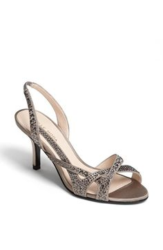Free shipping and returns on Pelle Moda 'Gretel' Sandal at Nordstrom.com. A glittering metallic finish highlights the asymmetrical curves of a dazzling slingback sandal.