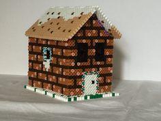 Es una casa de hama beads en  3D