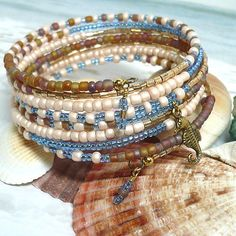 Some of these jewelry designs use materials straight from the ocean: shells, coral, sea glass, pearls. Other are inspired by seaside colors: aqua blues, sandy browns, foamy whites. As you browse these jewelry designs, watch for the occasional starfish and seahorse, too. You'll want to break out our flip-flops along with your bead stash.