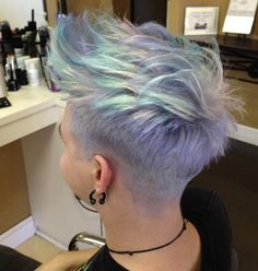 [Image: Short hair, shave at the sides, dyed pastel shades of blue and purple and white.]