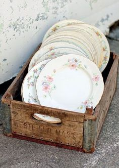 vintage plates in an old crate.