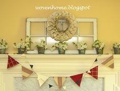 Spring Mantel including antique window, vintage book page wreath, penant banner, fresh flowers