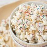 White Chocolate Party Popcorn- great for kids parties, bridal showers and more! Only requires three simple ingredients! So delicious!