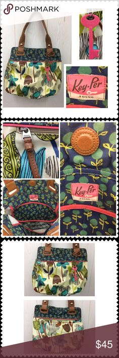 """Key-per by FOSSIL purse handbag Coated canvas purse by Key-per by FOSSIL. Tulip/Floral print. Magnetic closure. Double handles. Inside zipper pocket. Two open pockets inside (fits cell phone) Very clean and nice! Measures approximately 16"""" x 13"""" x 4"""" Fossil Bags Satchels"""