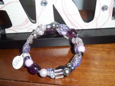Purple and clear beaded memory wire bracelet