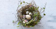 twigs, moss, lichen, fern, blossoms and speckled quail eggs - a natural easter