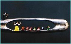 "Miniature sculpture of Snow White and the seven dwarfs in the eye of a needle by Willard Wigen. """"It began when I was five years old,"" says Willard. ""I started making houses for ants because I thought they needed somewhere to live. Then I made them shoes and hats. It was a fantasy world I escaped to. That's how my career as a micro-sculptor began."""