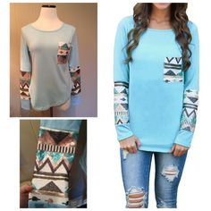 """Sequin tee New embellished boutique tops! Pretty aqua blue with Aztec patterned sequins on pocket and sleeves. Shirttail hemline-shorter on sides.  Four sizes available! These do run small so please check measurements!  S: 17""""UA, 20""""L at shortest, 23""""L at longest M: 18""""UA, 20""""L at shortest, 23""""L at longest L: 19""""UA, 21""""L at shortest, 24""""L at longest  XL: 20""""UA, 21""""L at shortest, 24""""L at longest Tops Tees - Long Sleeve"""