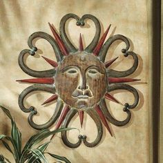 Dance of the Sun Metal Wall Sculpture in Multi-Toned Weathered by Design Toscano. $72.90. Over two feet in diameter. Hand painted. Hand crafted metalwork. MH73754 Features: -Hand crafted and hand painted. Construction: -Metal construction. Color/Finish: -Highlighted in multi-toned weathered finish.