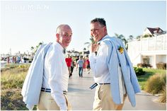 Walking the iconic boardwalk along the beach.   Hotel Del Wedding, Photography by Bauman Photographers  View More: http://baumanphotographers.com/blog/weddings/2014/09/hotel-del-coronado-wedding-coronado-ca/
