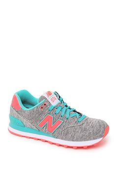 The women's 574 Glitch Collection Sneakers by New Balance offer a mix of colorful fabric and textures. We love the contrasting laces and neon pops of color throughout. Best of all, these sneakers are super comfortable so you can show them off with style!	Lace up	Imported