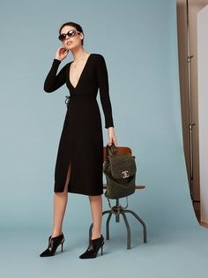 Just a really hot dress that also happens to be office appropriate. This is a calf length, form-fitting, wrap dress with a deep-v neck.