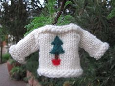 I knit these tree ornaments using Linda Dawkins's free pattern on Ravelry. She's got some cute designs.