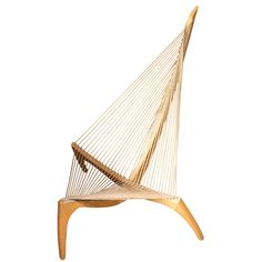 """The Harp Chair by Jorgen Hovelskov, 1966: The 'Harp"""" form was inspired by the  he bow  and halyard of a Viking ship."""