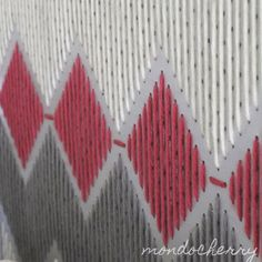 graphic design with wool on a pegboard