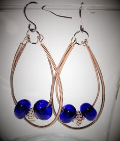 Earrings using upcycled brass guitar strings and lampwork beads