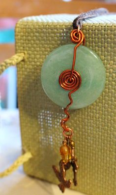 Aventurine wire wrapped donut pendant necklace with charms