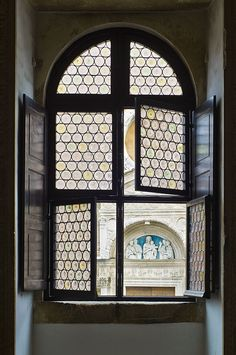 Della Robbia Lunette decorating San Domenico Church through one of the windows of the Ducal Palace, Urbino, Le Marche Photo by Claude Victor Offray III Old Windows, Windows And Doors, Interior Windows, Through The Window, Great Photos, Facade, Stained Glass, Decoration, Italy