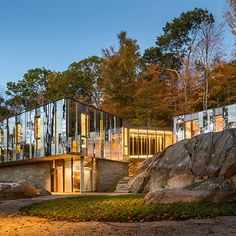 The US firm KieranTimberlake has nestled a family home into a rocky outcrop in New York, with mirrored cladding that reflects the forested landscape and sky