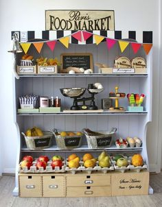 Mega Roundup of DIY Play Store Inspiration - love the Paris market.  Also need a flower shop, tea shop, clothing store, a bakery, a book store or library, doctor's office, school...Great toy storage.