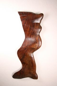 Neil Geisler sculpture of claro walnut - American sculptor; redwood sculpture