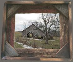 Crumbling old barn on a snowy country highway.  Photo taken by me and framed in Rustic, Weathered Wood Picture Frame 8x10