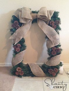 We have a sneaking suspicion that there's a frame under all that greenery...what a neat way to create a fun wreath for the winter season! Add vintage ornaments to give it a bit of sparkle.