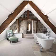What a fabulous bathroom. Just get rid of the carpet and change one of those walls into windows. Perfect.
