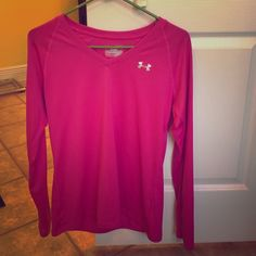 Long sleeve Under armour work out shirt Bright fuchsia long sleeve work out top. Worn one time. I like workout tops that cover my boogie. :/ perfect condition. Under Armour Tops Tees - Long Sleeve