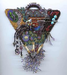 Bead embroidery  by Karen Cohen - I like the fringe work...