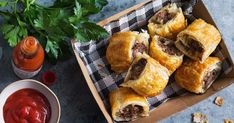 For a fiery kick, dunk these cajun-spiced beef mince sausage rolls into spicy Tabasco and tomato dipping sauce.