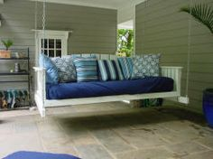 This daybed swing looks so comfy...would be fun to chill outside rain or shine