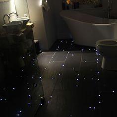 Fibre Optic starry night sky bathroom floor!  chose a polished concrete floor so the lights were random, not set into the grout